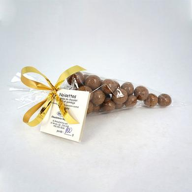 Hazelnuts coated with milk chocolate and gianduja